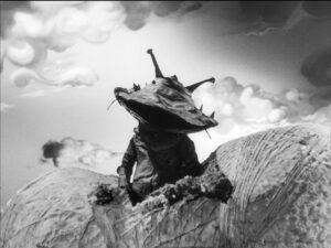 『ウルトラQ』で、お金に執着している少年が怪獣カネゴンに変身してしまう、15話「カネゴンの繭」。画像はULTRAMAN ARCHIVES『ウルトラQ』Episode 15「カネゴンの繭」(ポニーキャニオン)